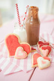 Pink cookies and milk Stock Image