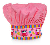 Pink cooking hat, with multi-colored pattern, hearts, flowers and owls. The pattern on the cap in the colors yellow, orange, red, Royalty Free Stock Photos