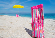 Pink cooler bag. With a bottle of water in the sand Royalty Free Stock Photo