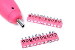 Pink  cordless screwdriver and bits Royalty Free Stock Photos