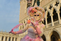 Pink costumed masked woman. At Doge's Palace in Venice Royalty Free Stock Photo