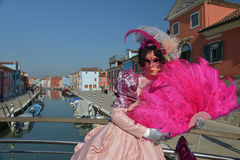 Pink costumed masked woman. Portrait in Burano Island Royalty Free Stock Photo