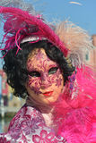 Pink costumed masked woman portrait. In Burano island Stock Photo