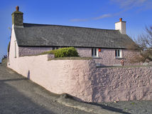 Pink cottage. Pretty home on Welsh coast royalty free stock photography