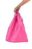 Pink cotton bag with man hand on white background Stock Photos