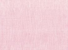 Pink cotton fabric. A close up of pink cotton fabric for a background, scrapbook, cards, web site and other uses Stock Photos