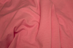 Pink cotton fabric background. This is a closeup photograph of Pink cotton fabric Stock Images
