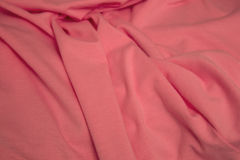 Pink cotton fabric background. This is a closeup photograph of Pink cotton fabric Stock Image