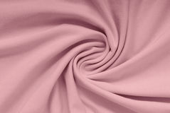 Pink  cotton textile,  lilac knitting cloth,. Pink  cotton textile, beautiful shape, lilac knitting cloth,  beautiful  background Royalty Free Stock Photo