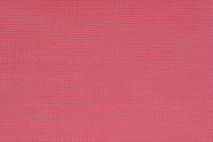 Pink cotton texture for the background. Closeup view. Stock Photos