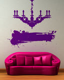 Pink couch with dummy of chandelier Royalty Free Stock Image