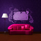 Pink couch with empty frame Stock Photography