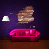 Pink couch with splash hole and standard lamp Stock Images