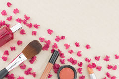 Pink crape myrtle petals with cosmetic. Brush and perfume with copy space royalty free stock image