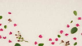 Pink crape myrtle petals, leaves and budding flowers. On muslin fabric with copy space Stock Photo