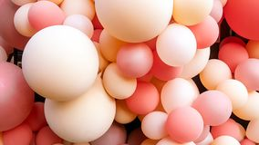 A bulk of pink and cream balloon stock photos