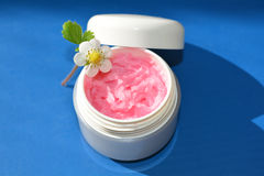 Pink cream, lips balm. A small dose with strawberry cream Royalty Free Stock Photo