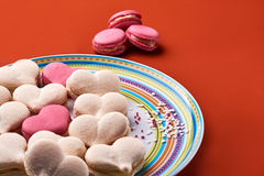 Pink and cream macaron on orange background Royalty Free Stock Photo