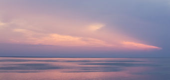 Pink creamy sunset over the sea Royalty Free Stock Images