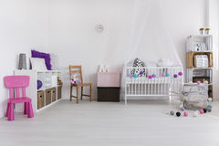 Pink creates the cosiness. Shot of a modern spacious nursery room for a girl royalty free stock photography