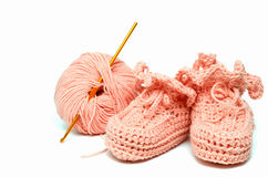 Pink crocheted babby's bootees Royalty Free Stock Image