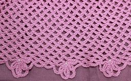 Pink crocheted background. Whith perl Stock Photos