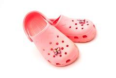 Pink crocks Stock Image
