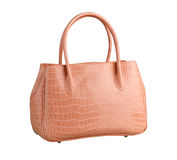 Pink crocodile woman leather handbag isolated  Stock Images