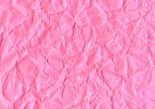 Pink crumpled paper. Pink background of crumpled paper Royalty Free Stock Photography