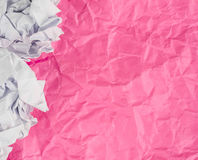 Pink Crumpled paper background with crumpled paper ball Royalty Free Stock Photography