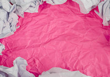 Pink Crumpled paper background with crumpled paper ball Royalty Free Stock Image