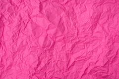 Pink crumpled paper texture as background stock photo