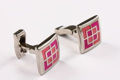 Pink cufflinks Stock Image