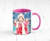 Pink cup with bright pink handle. Sitting on the table, with a print of girl Royalty Free Stock Photos