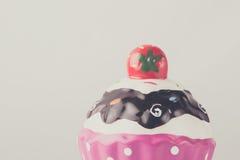 Pink cup cake , plaster savings bank Royalty Free Stock Images