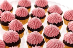Pink Cup-cakes close-up. Delicious sweet buffet with cupcakes on the plate Stock Photography