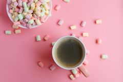 Pink cup with coffee and marshmallow in bowl. On pink background Royalty Free Stock Photos