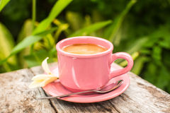 Pink cup of coffee on wooden table Stock Photography