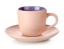 Pink cup and saucer isolated Stock Images