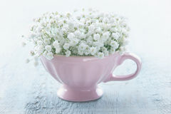 Pink cup with white flowers Stock Image