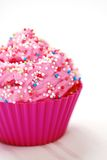 Pink cupcake. Birthday surprise on white Stock Photography