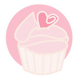 Pink Cupcake. A pink cupcake decorated with a small heart Royalty Free Stock Photos