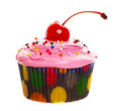 Pink cupcake. A colorful cupcake with a cherry on top stock images