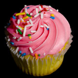 Pink Cupcake on Black. A pink decorated cupcake on a black background Royalty Free Stock Photography