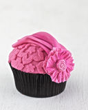Pink Cupcake. Pink couture cupcake with embossing and flower in fondant icing Stock Photos