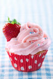 Pink cupcake with fresh strawberry and copy space Royalty Free Stock Images