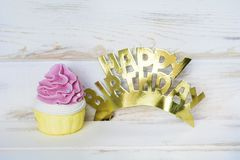 Pink Cupcake and Happy Birthday Golden Text. Pink Cupcake and Happy birthday golden sign for greeting cards stock photography