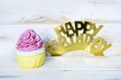Pink Cupcake and Happy Birthday Golden Text. Pink Cupcake and Happy birthday golden sign for greeting cards stock image