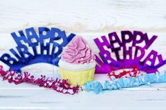 Pink Cupcake and Happy Birthday Text. Pink Cupcake and Happy birthday purple and blue sign for greeting cards stock image