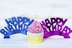 Pink Cupcake and Happy Birthday Text. Pink Cupcake and Happy birthday purple and blue sign for greeting cards stock photo
